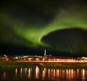 Iceland ReykjavikSOURCE: http://iceland.nordicvisitor.com/resources/Images/Iceland/reykjavik-city-break/ISCB-03/Northern-Lights-over-Reykjavik.jpg